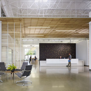 Design center built with healthy materials and featuring midcentury furniture.