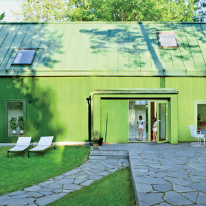once removed prefab sweden family facade green plannja roof panels