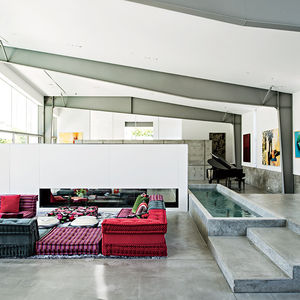 Desert Canopy House living room with Mah Jong sofa by Roche Bobois and water feature
