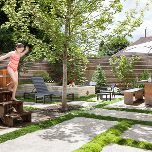 Custom backyard with a soaking tub and fire pit in Portland