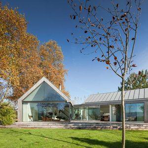 Modern farmhouse with glass walls