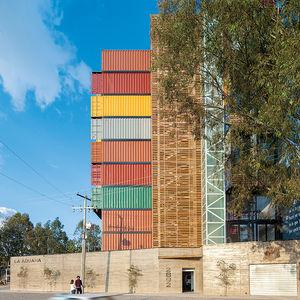 stacked high shipping containters pre fab mexico facade side concrete metal