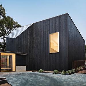 texas hold em renovation addition glass pavilion facade cypress paneling metal roof
