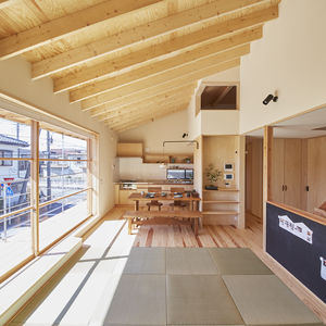 Japanese living room with 13 foot sliding glass door and blackboard wall.